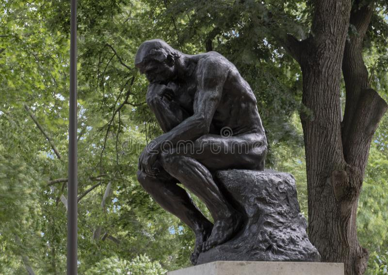 The Thinker by Aguste Rodin at the Rodin Museum entrance, Benjamin Franklin Parkway, Philadelphia, Pennsylvania. Pictured is `The Thinker` by Aguste Rodin at the stock photography