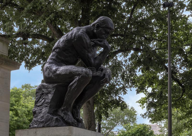 The Thinker by Aguste Rodin at the Rodin Museum entrance, Benjamin Franklin Parkway, Philadelphia, Pennsylvania. Pictured is `The Thinker` by Aguste Rodin at the royalty free stock photos