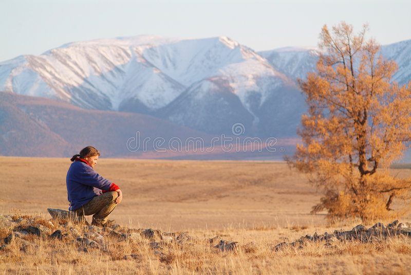 The thinker in the mountains royalty free stock photos