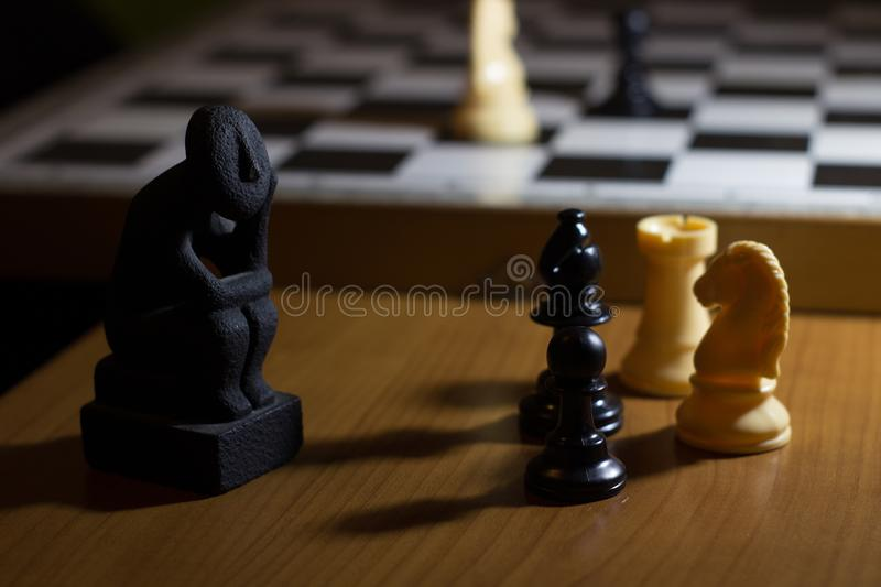 the thinker statue on a chess board coil small thinking about st royalty free stock photo