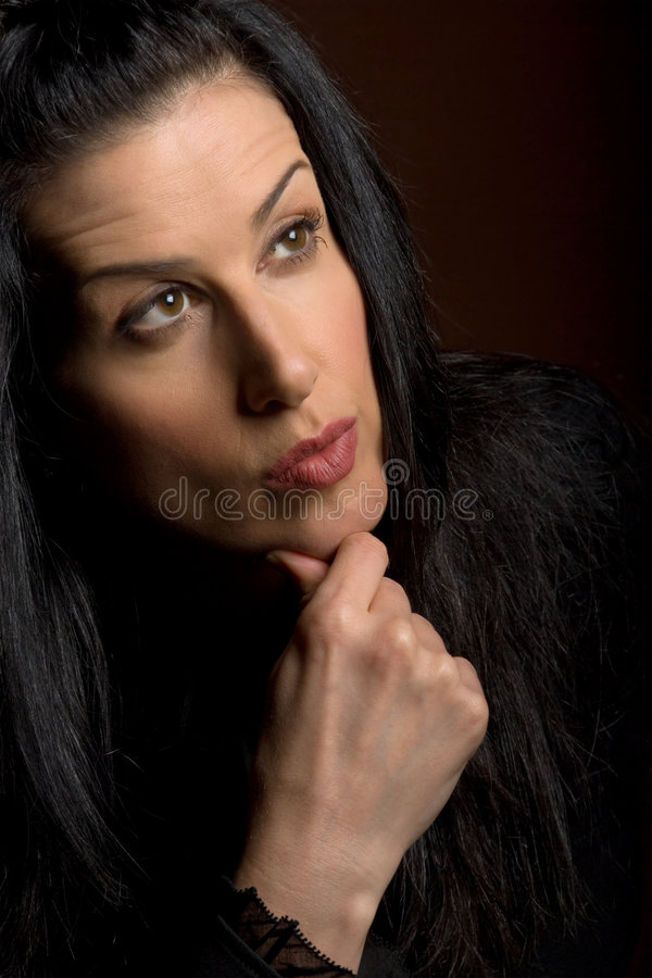 Thinking. Female studio shot with facial expression royalty free stock photo