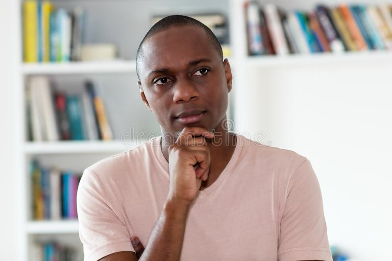 Thinking african american man with bald head stock image