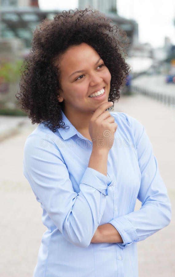 Thinking african american woman in the city stock images
