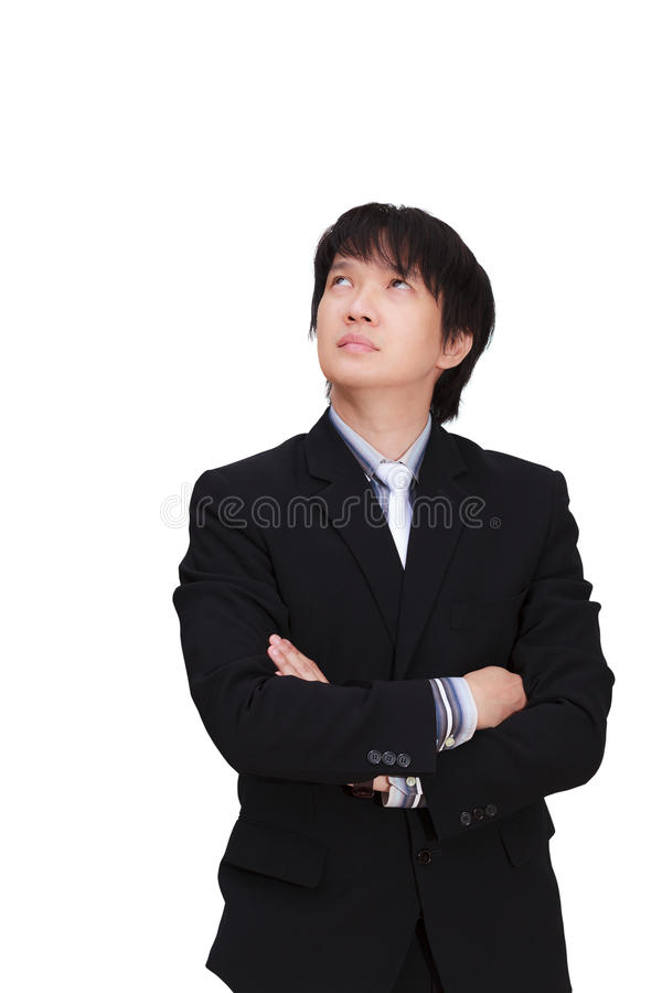 Thinking asian businessman, Isolated on white background. Closeup portrait of a asian young pensive businessman looking up at copyspace royalty free stock photo