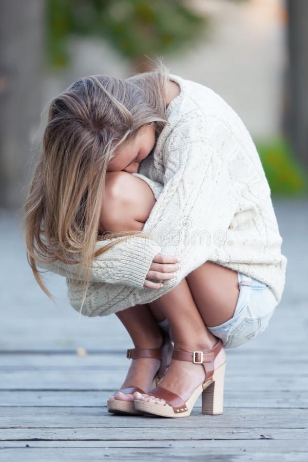Thinking of autumn. Girl is freezing thinking of autumn royalty free stock image