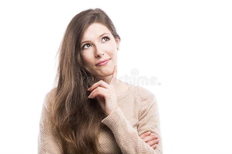 Thinking. Beautiful young woman with a thinking expresison, isolated over white background stock images