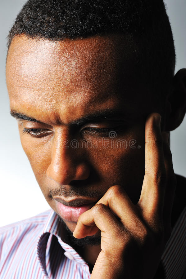 Thinking black man stock photography