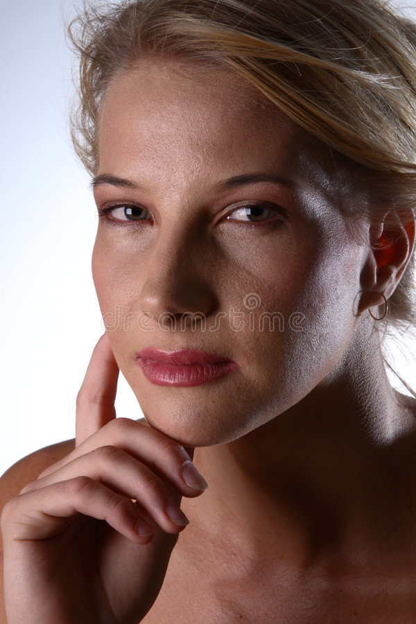 Thinking blond stock images