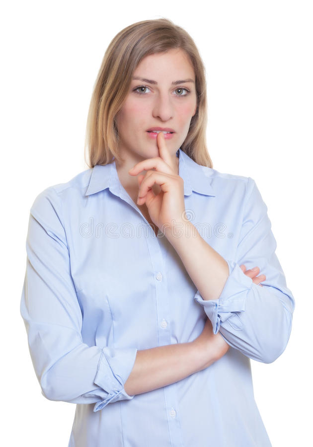 Thinking blonde german woman in blue blouse. On an isolated white background for cut out stock image