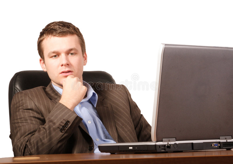 Thinking business man with laptop - smart casual. Close up royalty free stock photo