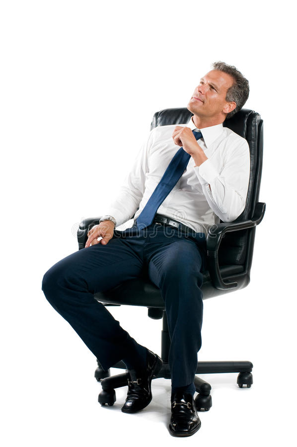 Thinking businessman. Dreamful pensive businessman sit on his business chair isolated on white background royalty free stock image