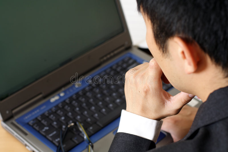 Thinking businessman stock photos