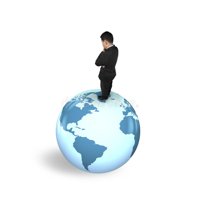 Thinking businessman standing on globe world map stock photos