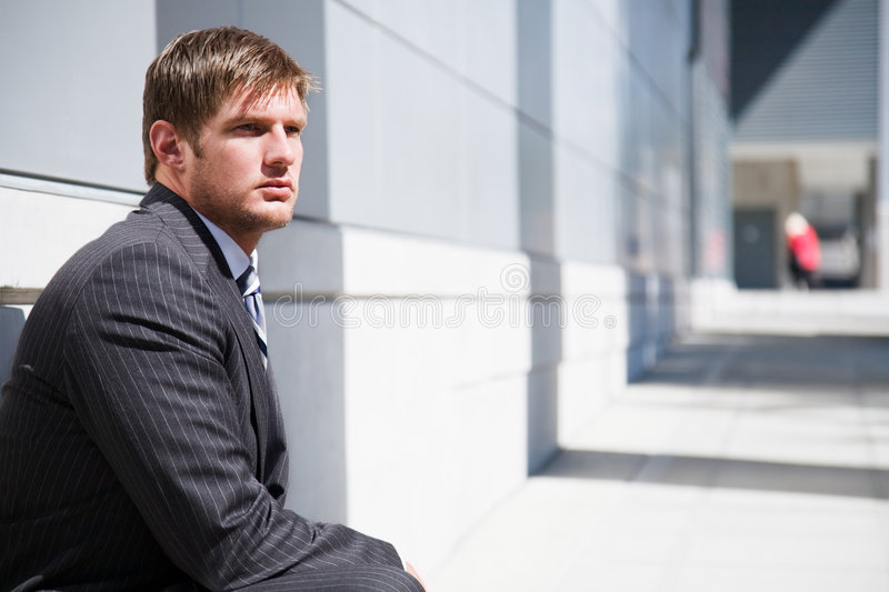 Thinking caucasian businessman royalty free stock image