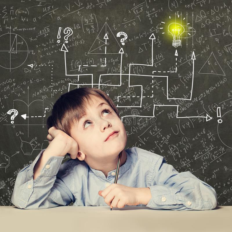 Thinking child boy with question signs and light idea bulb, education concept with math formula stock photography