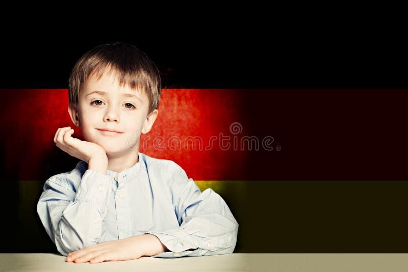 Thinking child boy student against the Germany flag background stock image