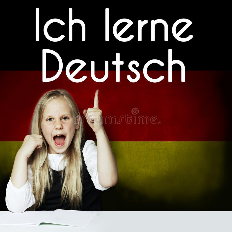 Thinking child girl student against the Germany flag background. Deutsch concept with inscription learn Deutsch on Deutsch royalty free stock photo