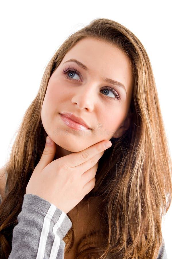 Thinking female looking upward. On an isolated white background stock photo