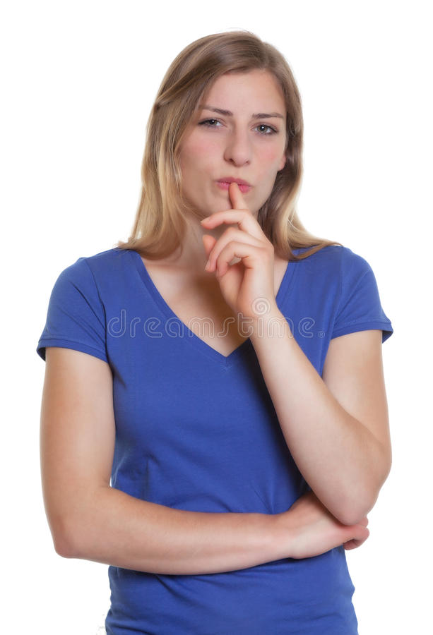 Thinking german woman in a blue shirt. On an isolated white background for cut out royalty free stock photo