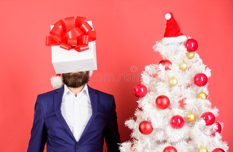 Thinking about gift ideas. Come up with good present. Gift service. Head downtrodden with thoughts what to gift. Man. Bearded formal suit carry gift box on head royalty free stock photos