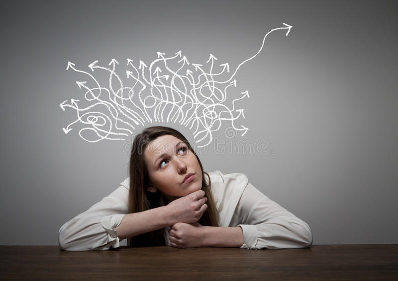 Thinking. Girl solving a problem stock photography