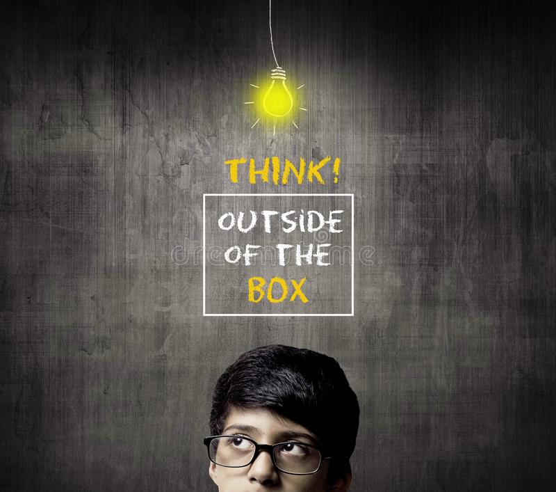 Thinking Half Head Of Genius Little Boy Wearing Glasses. Think outside of the box royalty free stock photography
