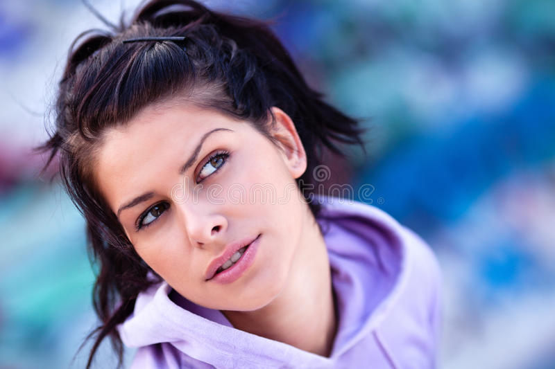 Thinking about him. Teenage girl looking up and aside and thinking about her love royalty free stock photography