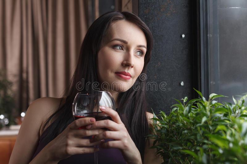 Thinking about him. Thoughtful middle-aged women standing with a royalty free stock photography