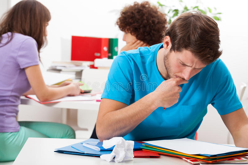 Thinking male student. Male student during thinking about new solution stock photo