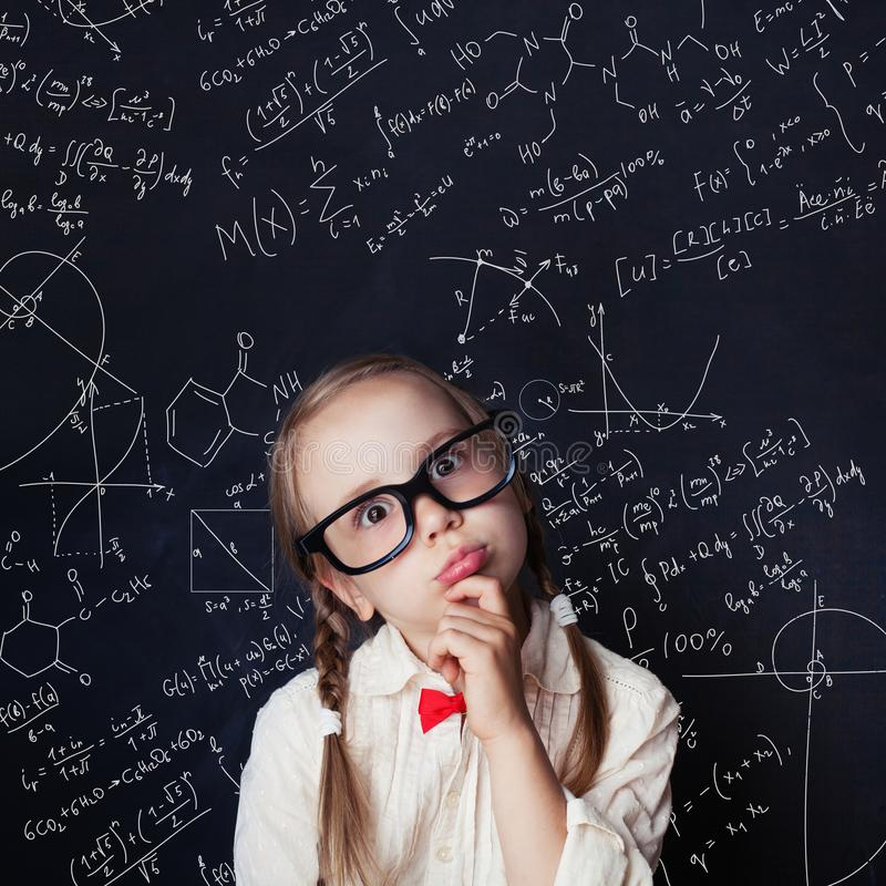 Thinking mathematics student on school blackboard stock images
