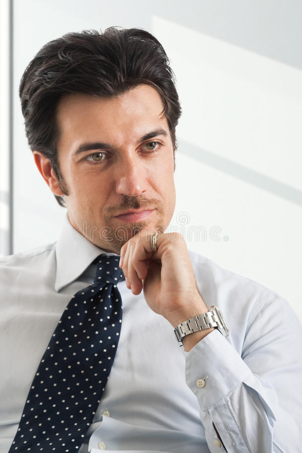 Thinking mature male manager portrait royalty free stock photo