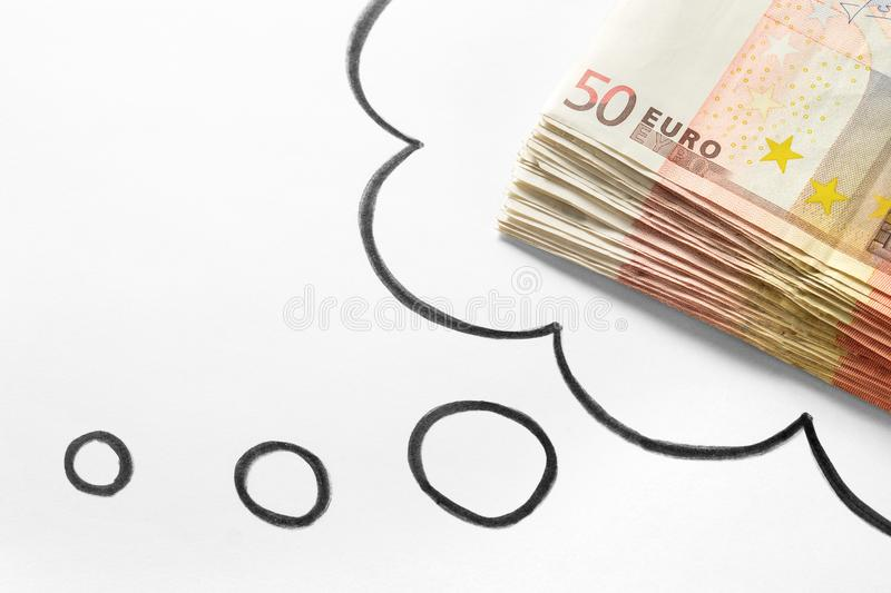 Thinking about money. Dreaming of rich and wealthy life. stock image