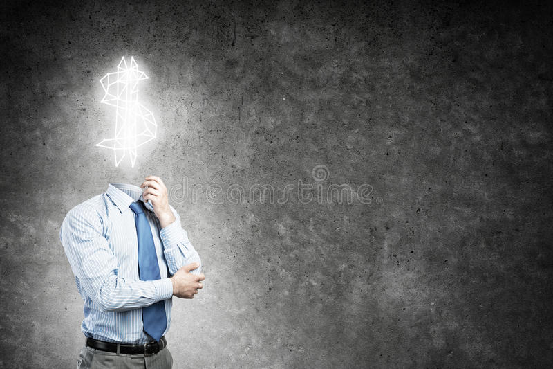 He is always thinking about money. Faceless businessman with dollar sign instead of head stock photography