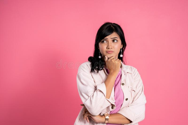 Woman thinking for new idea. Thinking for new idea. attractive woman look up daydreaming against pink background stock photos