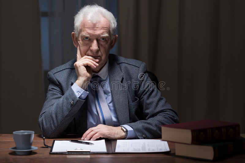 Thinking older man stock photo