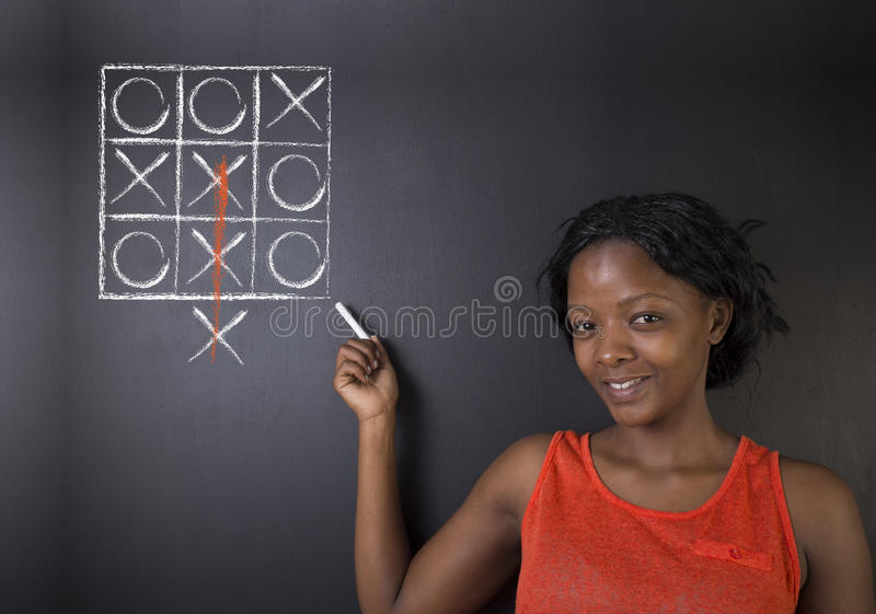 Thinking out of the box outh African or African American woman teacher or student royalty free stock photo