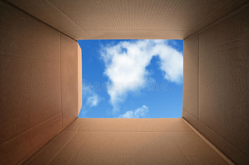 Thinking outside the box. Inside a cardboard box concept for moving house, creativity or thinking outside the box royalty free stock images