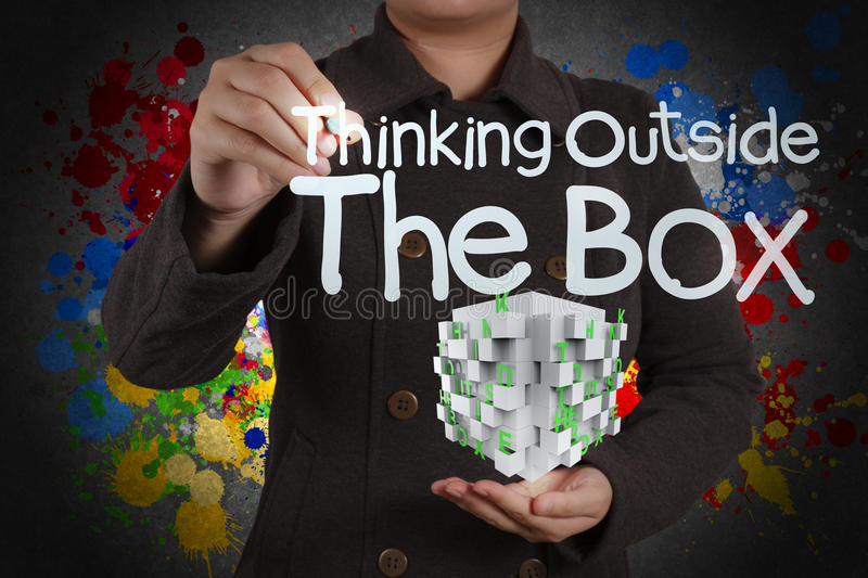 Thinking outside the box and splash colors royalty free stock photo