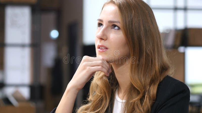 Thinking, Pensive Beautiful Girl Sitting Indoor royalty free stock image