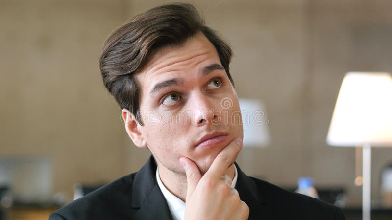 Thinking Pensive Businesman Portrait in Office royalty free stock photography