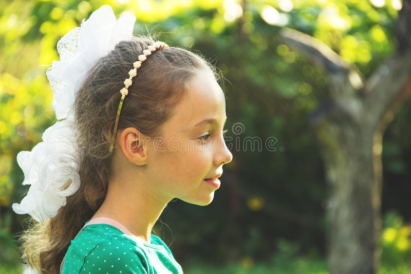 Thinking about - portrait of pondering little girl - at the summmer sunset stock photography
