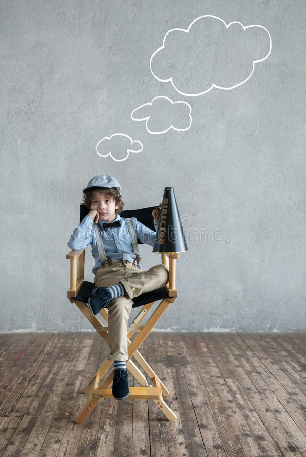 Thinking producer. Little producer with a speaker stock photos