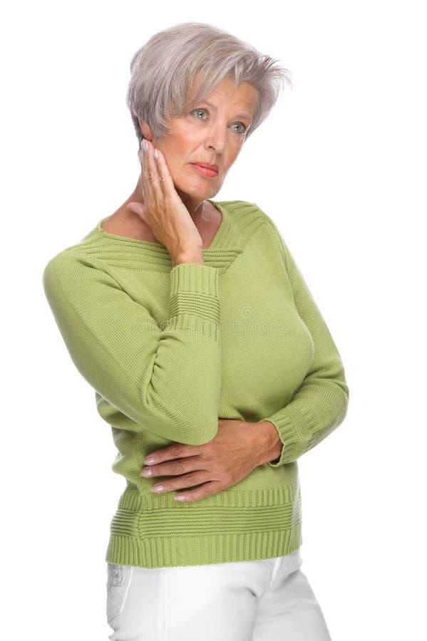 Thinking senior woman stock photo