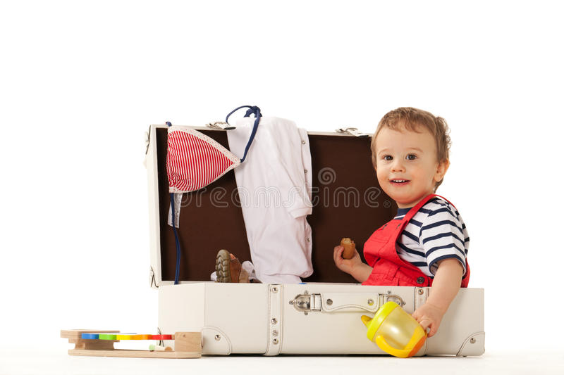 Thinking of summer. Boy in suitcase is ready for summer stock photos