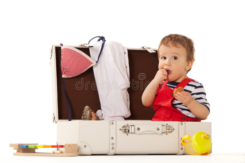 Thinking of summer. Boy in suitcase is ready for summer royalty free stock photography