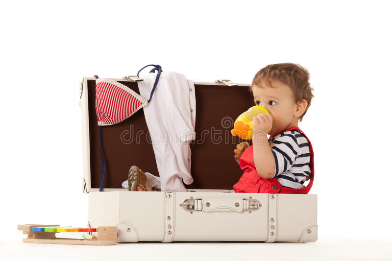 Thinking of summer. Boy in suitcase is ready for summer royalty free stock images