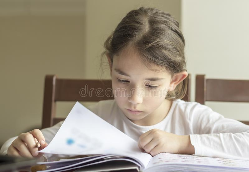 The elementry student is thinking stock photography