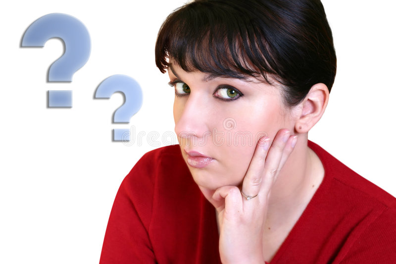 Thinking Woman. Young woman with hand on face royalty free stock image