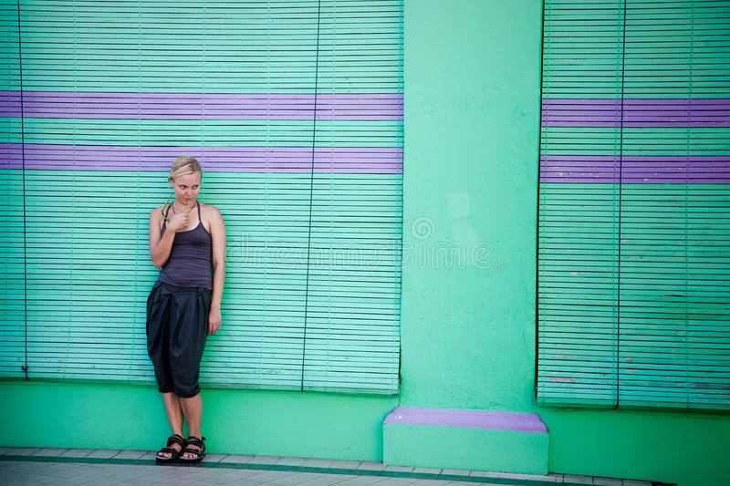 Download Thinking Woman Against City Wall Stock Photo - Image of leaning, adult: 13050810