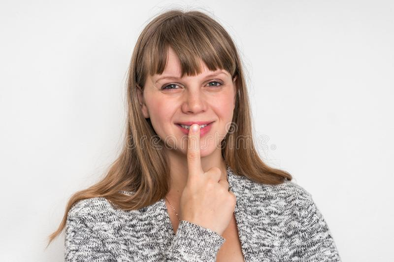 Woman with finger on her lips royalty free stock images